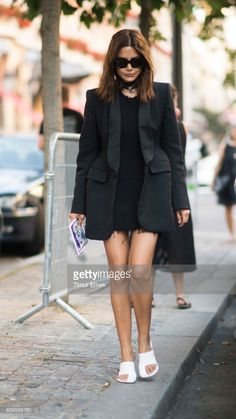 Christine Centenera seen in the streets of Paris on July 5, 2017 in Paris, France.