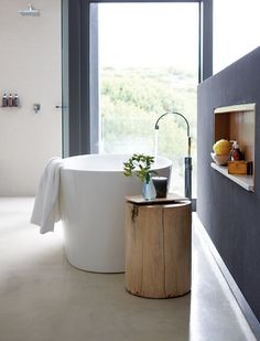 modern bathroom interior combined with wooden side table