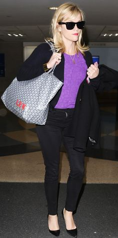 "Reese Witherspoon breezed through LAX in a purple top and a black cardigan, jacket, and pair of pants, and even her pumps and shades were black. She carried a Goyard tote bag personalized with her monogram in red letters (the ""L"" stands for her first name, Laura). #InStyle"