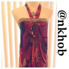 Sequins Halter  Dress Beautiful vibrant abstract colors adorn this dress with a gold sequined band around the bodice.  Hidden back zipper with hook closure.  Halter style that ties at the neck. Very light and flowing.  Bust measures 20 inches, length is 36 inches. Fully lined.  Both shell and lining are 100% polyester.  NWT (B) Authentic Icon Dresses