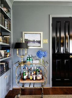 "This bar cart in interior designer Brooke Inabnett's home office is the definition of posh elegance. Read more about bar carts and ligthing them in our blog post, ""Home Is Where the Cart Is: Lighting and Loving Your Bar Cart"" and click through the image from our site to see it in its original context in Rue Mag, in an interview with Brooke about her office. Photo by Emily Hart."