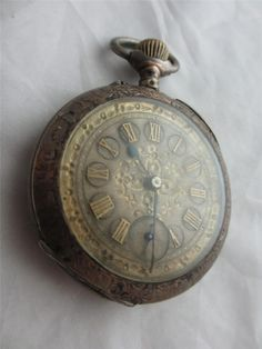 Antique sterling silver French pocket watch with gold inlaid numerals