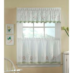 Give your home a delicate, garden-inspired accent with this charming three-piece window curtain set. A bright snowdrop, daisy and early flower pattern is embroidered on a crisp white ground and accented with sage-green macrame lace for a fun effect.