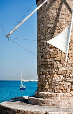 Windmill in Mandraki harbour of Rhodes.