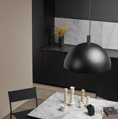 The iconic Studio Lamp series, designed by Laura Bilde, and the Globe Light series, designed by Emil Thorup, are part of the permanent lighting. Studio Lamp, Nordic Kitchen, Home Modern, Pendant Lamps, Black Kitchens, Globe Lights, Danish Design, Home Interior, Furniture Design