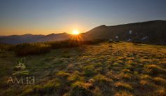 Slnko sadá medzi Chopok a Ďumbier