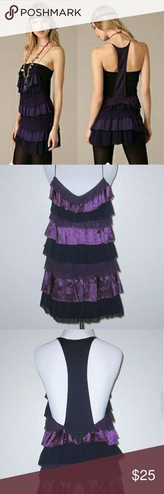 "Free People Lots of Ruffles Purple Tunic Beautiful, rich shades of purple in ruffled tiers of silk, crinkled chiffon, and gauze chiffon Deep racer back and metallic spaghetti straps Can be worn as a tunic or as a mini dress Retail: $128 Shell: 100% Silk Lining: 100% Cotton Dry clean Made in China  Measurements: Bust: 32"" Waist: 32"" Hips: 37"" Overall Length: 32""  Condition: Excellent good condition; tunic is clean and shows minimal wear. No holes, stains, rips, pulls, or pilling. Free People…"