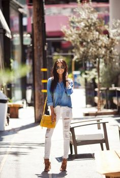 Racquel Natasha is wearing a well worn denim shirt from Zara, white ripped jeans from Black Orchid Denim