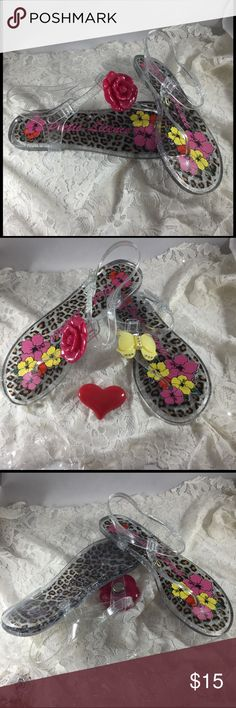 Poetic Licence Clear Jelly Jangle Sandals Never worn clear jelly flip flops.  Has 3 plastic snap on accents....rose, heart, and bow.  Very cute.  Shoes say Size 39, but box says size 8 and they fit like an 8. Poetic Licence Shoes Sandals