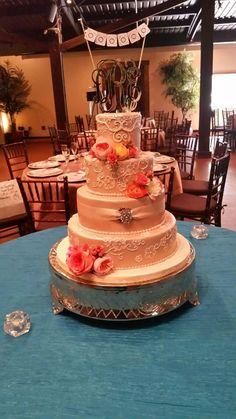Blush peach buttercream and fresh flowers wedding cake
