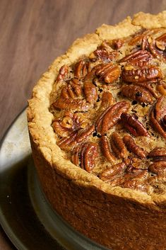 Deep Dish Pecan Pie is tall, beautiful, and delicious. It has more than the usual amount of gooey pecan pie pie filling inside a cream cheese crust. - Bake or Break