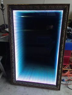 "This is an ""Infinity"" design LED mirror that I constructed several months back. An old Army buddy of mine found a beautiful 4 foot by 2 1/2 foot frame that someone was throwing away, and we decided to make a LARGE version of one of these mirrors!"