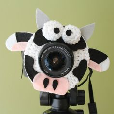 Crochet Camera Lens Shutter Buddy - Daisy the Cow (Etsy $15.99)
