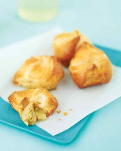 A warm, cheesy artichoke filling is at the heart of these puff pastry pockets.