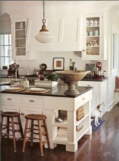 I like the range vent hood blending in with the cabinets. Also, the shelves at the end of the island.