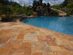Travertine. Doesn't slip when wet or get hot when hot.