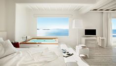 Imagine soaking in that tub looking out at that view! Cavo Tagoo - Mykonos, #Greece