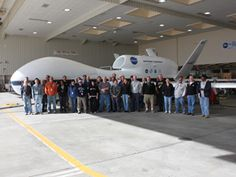 NASA's Climate Drones Research at 65,000 Feet ...  This month marks the start of a five-year mission to collect data from 65,000 feet up—data that might change what we think we know about global warming.   Photo: The Attrex scientists and their Global Hawk drone.