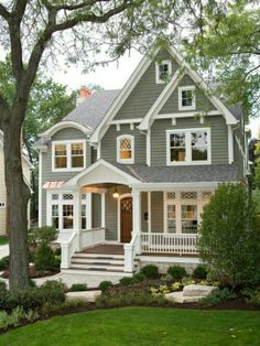exterior color scheme very warm grey, bright white trim, soft, muted yellow door... Love these colors