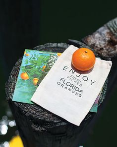 This couple handpicked oranges from trees on the island for guests' welcome bags