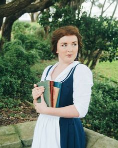 """""""I want much more then this provincial life!"""" A shot from today taken by the lovely @lapin_papier and then put through vcso on my phone because I don't have enough energy for Photoshop! We took so many great photos, can't wait to show you all! . . . . . #belle #bellebluedress #disneycosplay #disneyprincess #beautyandthebeast #beautyandthebeastcosplay #bellecosplay #sewing #handmade #books #dress #disney #cosplayphotography #photography #photoshoot #cosplayphotoshoot"""
