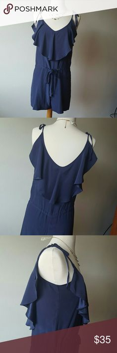 Shoulder Straps Silk Romper Romper comes in blueish gray color and features a plunging V-neckline, ruffle detailing at neckline front and back, thin shoulder straps (adjustable), and control waist. This item is pre-owned with four small stains in the front top. 100% Silk. AKA New York Dresses Mini