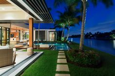 Fronting 100 feet along the Intracoastal Waterway, this modern Boca Raton, Florida, home brings the outdoors in. Glass walls offer prime waterfront views, with the living areas and master retreat opening to the small infinity-edge pool. The home'sfront courtyard has an ipe walkway crossing over a reflecting pond.