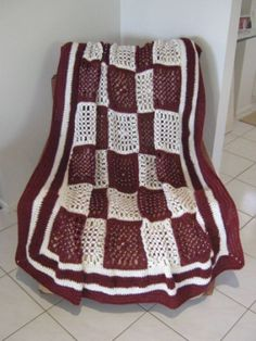 Butterfly loom rug - the squares are done on a butterfly loom and the border is crocheted.