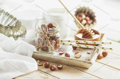 Honey in the wooden bowl, hazelnuts and jar with milk on the wooden tray. Food & Drink Photos