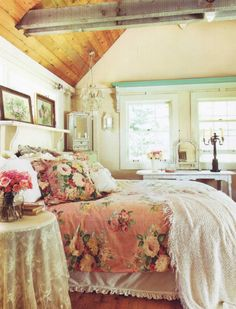 romantic prairie style - like the wooden ceiling with the white painted paneling and the big rose print with vintage flower paintings.
