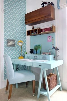 office nook - photo by Evelyn Muller. Not really modern enough for me. But I do like the back colour and the floating shelves.