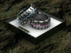 His and hers tire track rings- its different.... but I think its cool! Maybe with a birthstone color?