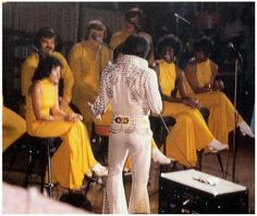 Nice 'rear view' - Elvis - during a concert with back-up singers