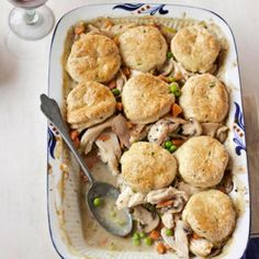 This comforting dish is filled with mushrooms, carrots, and peas and topped with flaky biscuits.