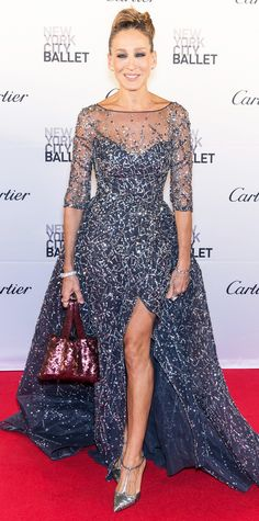 Sarah Jessica Parker at the New York City Ballet Gala, stealing the spotlight in a stunning cloud of tulle, courtesy of Zuhair Murad Couture, exquisitely embroidered with confetti-like sparkles all over. A crimson sequined purse and T-strap SJP pumps completed her look.