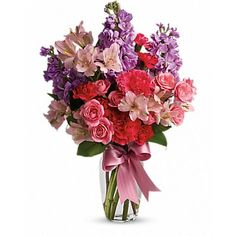 Send her on a dreamy stroll through a garden with this perfect-for-any-occasion bouquet. Soft #lavender and pink #flowers delight with a sweet smell; a pink ribbon adds to the feminine look of this traditional #arrangement.