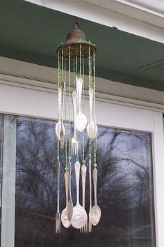 Wind Chime made from silverware.  Great creative idea.  SBG thinks the thing at the top is either a bell or the beauty ring of an old hanging light fixture.