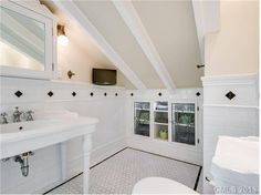 This entire house is sickeningly beautiful but this little bathroom under the eaves is simply drool worthy!