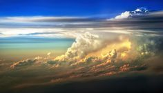 This huge thunderstorm was shot out of the window of a plane at 35000 feet somewhere over the desert southwest as the sun set in the west.  Awesome and beautiful as long as you don't have to fly through it.  http://fineartamerica.com/featured/fire-in-the-sky-from-35000-feet-scott-norris.html  www.scottnorrisphotography.com