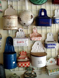 Great collection of vintage tins and colanders for a kitchen