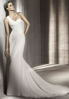 Pronovias    Complete Details    Silhouette: A-Line  Neckline: One-Shoulder  Gown Length: Floor  Train Style: Attached  Train Length: Sweep  Fabric: Gauze  Color: White  Size: 4 - 24  Price: $$$   Price Guide