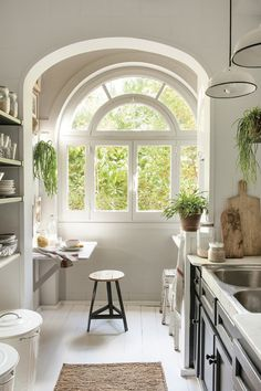 White kitchen with large arched window and kitchen furniture in black_ 00451211 Kitchen Interior, Interior And Exterior, Kitchen Decor, Cozy Kitchen, Kitchen Furniture, Kitchen Ideas, Bohemian Bedroom Design, Building A Kitchen, Interior Styling