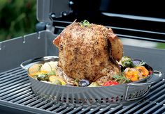 """The stainless steel poultry insert removes easily to switch between the two functions, or use them together for a simple complete meal. Beer can chicken aficionado? The Poultry Roaster will accommodate a variety of liquids. Just insert the 12 ounce can of your choice of beer or juice into the center of the roaster and the liquid will infuse poultry with your flavor favorites. Dishwasher safe. Designed for use with the Gourmet BBQ System™ Cooking Grates.Dimensions: 15.9"""" L x 13"""" W x 3.6"""" H"""