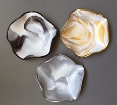 Marbled Neutral Colored Trinket Dishes; hand molded in polymer clay. A beautiful and functional piece to keep track of jewelry items. Makes a great gift all year round! Take your pick on 3 available colors; Gold, Silver and Black & White. ($17) #jewelrydish #trinketdish #polymerclay