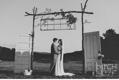 Ogontz Camp, NH Wedding Photography by Birch Blaze Studios. Rustic summer camp wedding inspiration. Ideas for rustic wedding details. Antique doors, antique window sash processional gate entrance. Ceremony ideas.