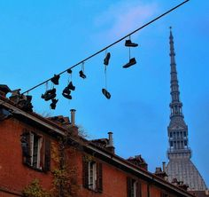 #Torino #Turin #shoes #flying #mole #blue #sky #details #abstract #abstractart #PlacesOfTurin #travel #italy #aroundtheworld #igtravel #instatravel #photooftheday #architecture #art #buildings #geometry #tourism #travelling #ciauturin #architexture #city #autumn - photo by @pacellig_