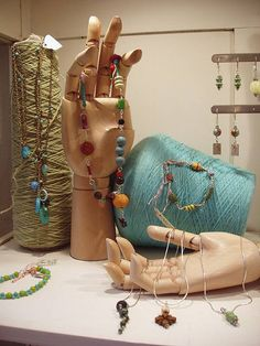 jewelry display at Red Shoes shop in Ann Arbor MI with beautiful articulated wood hands