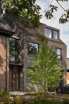 Clad in grey-brown clay shingles, the extension has apertures of varying sizes and a pitched roof. Pool Drawing, Toronto, Basin Design, Dormer Windows, Brick Building, House Extensions, Terrazzo, Architecture Details, Facade