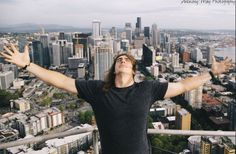 Luke Willson #82 Seattle Seahawks above the Seattle skyline