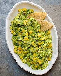 The sweetness of mango is right at home in this fresh, lime-tinged guacamole, which takes only 15 minutes to make.  Slideshow: Terrific Guacamole Recipes
